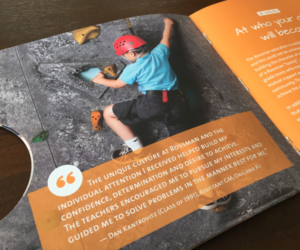 viewbook interior spread showing boy on climbing wall