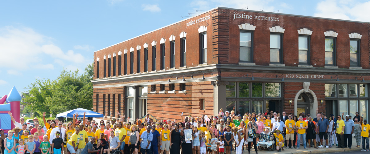 photo of a crowd of supporters outside the Justine Petersen building