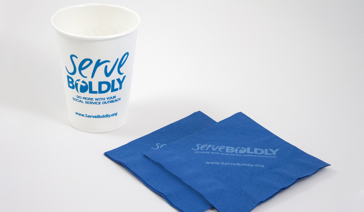 Serve Boldly napkins and cups with the logo